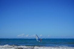 a man on a windsurfing board in the sea