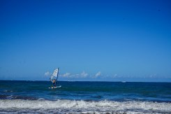 man on a windsurfing board in the Dominican Republic