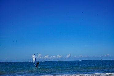 man doing windsurfing in the sea