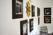 6 photo frame and a golden star hanging on the wall