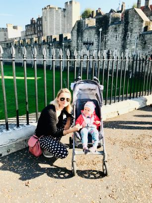 woman and little girl in stroller in front of the tower of London
