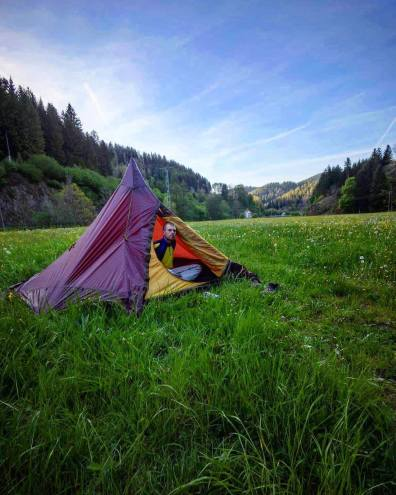 A male backpacker off-the-grid camping