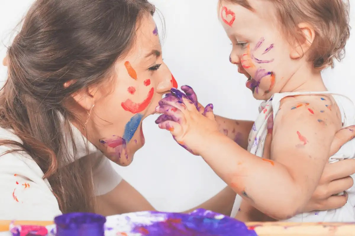 happy mom and daughter after playing with finger paints together