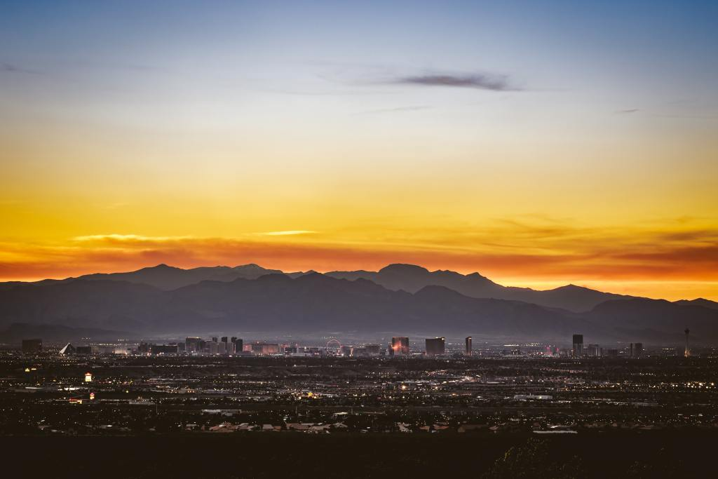 The Las Vegas city skyline against the mountains in a beautiful sunset