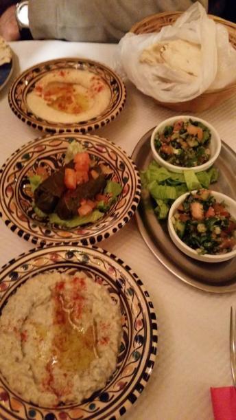 Pita bread with hummus, baba ghanouj, dolmades and tabouli