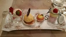Dessert tasting plate with rum baba, sortbet, panna cotta and custard