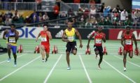 Runners compete in the men's 60 meter final won by Bromell of the U.S. at the IAAF World Indoor Athletics Championships in Portland