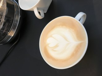 Our final attempt at Latte Art showing that with a little practice you can create something special