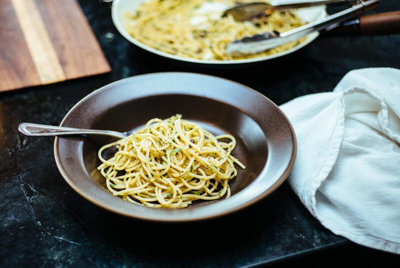 Rustichella spaghetti with anchovies and capers plated in a Heath Ceramic bowl