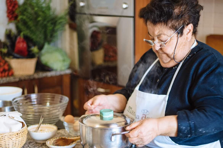 Mamma Agata covering her famous Mamma Agata tomato sauce in Ravello Italy, the taste edit san francisco