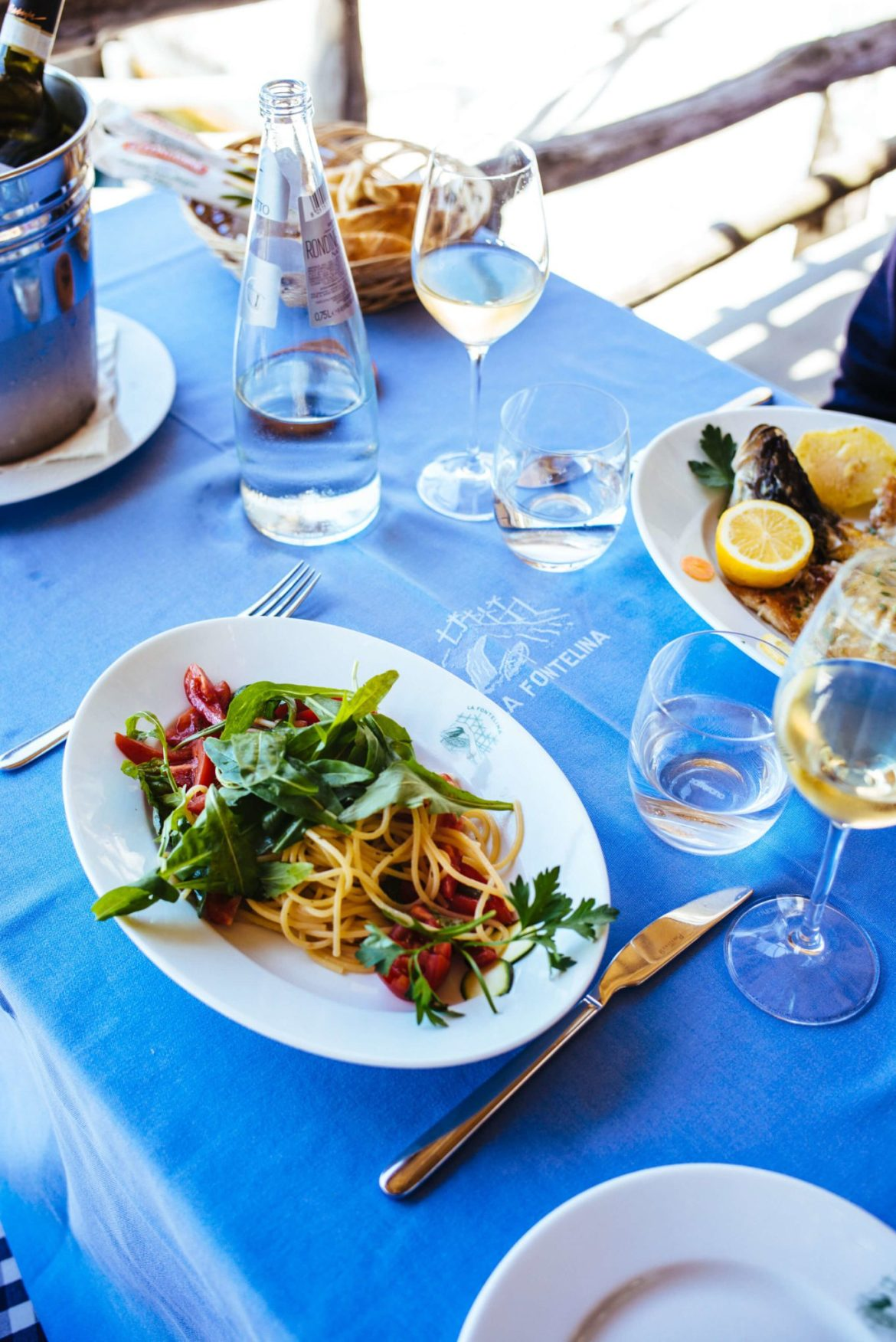 Take a boat to eat lunch on the water at Ristorante La Fontelina in Capri, Italy, The Taste Edit