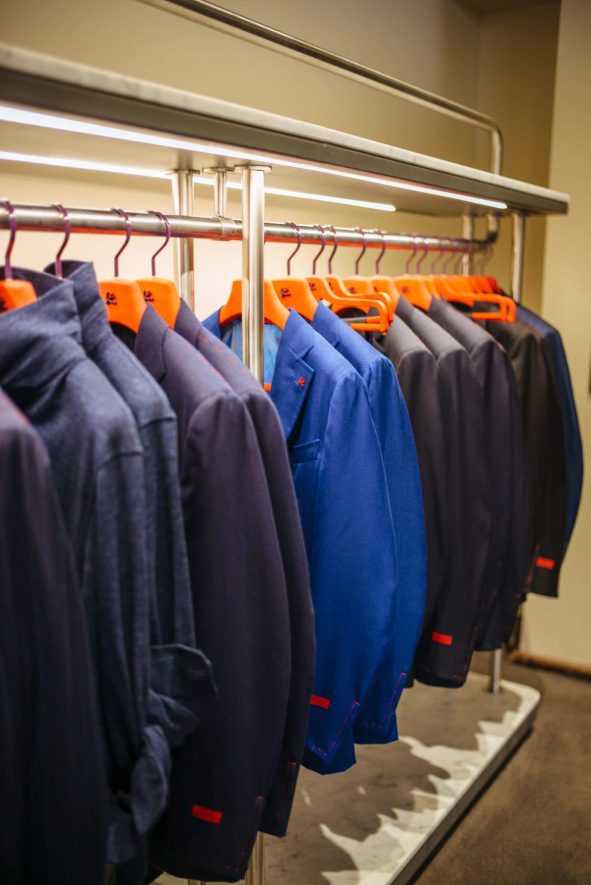 Suits with red hangers at Isaia San Francisco Store, Neapolitan Isaia suits in the historic VC Morris Frank Lloyd Wright San Francisco, The Taste Edit