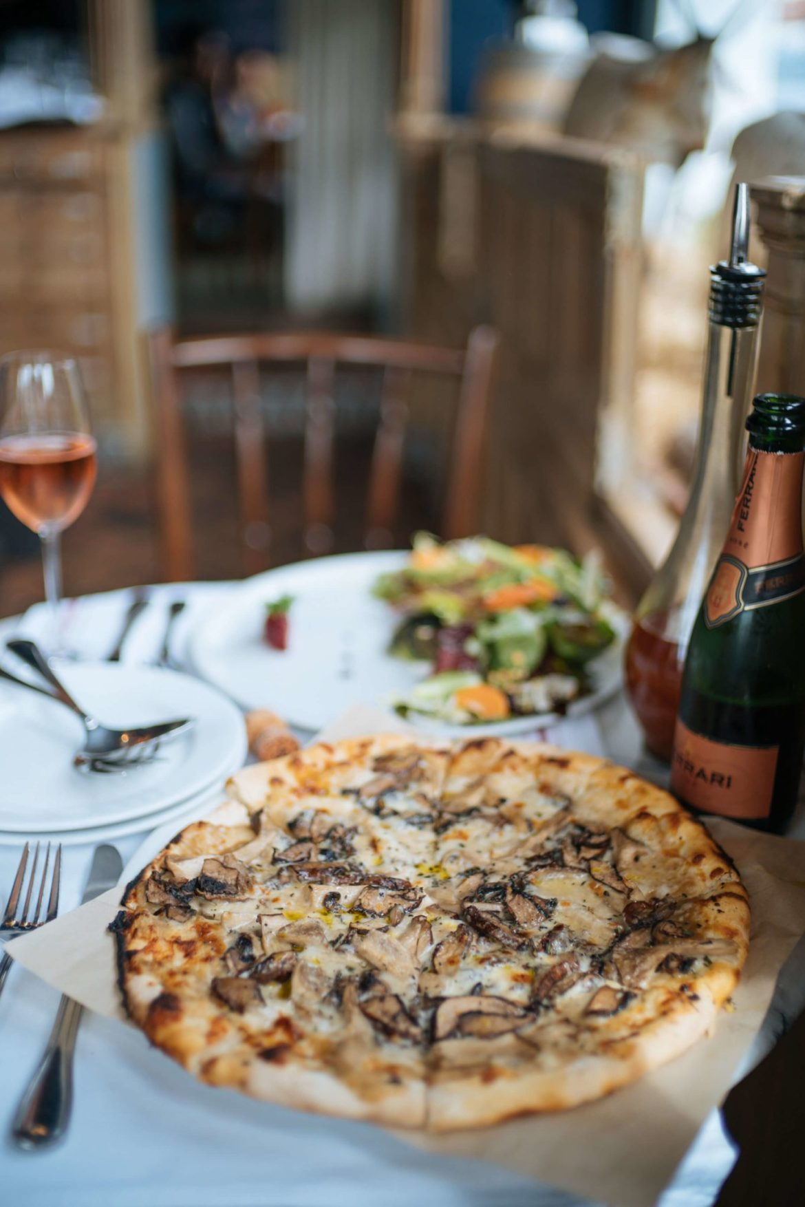 Visit La Bicyclette in Carmel By The Sea, try the wood fired pizza Champignons, made with portobello and oyster mushrooms, mozzarella, thyme, caramelized onion and truffle, thetasteedit
