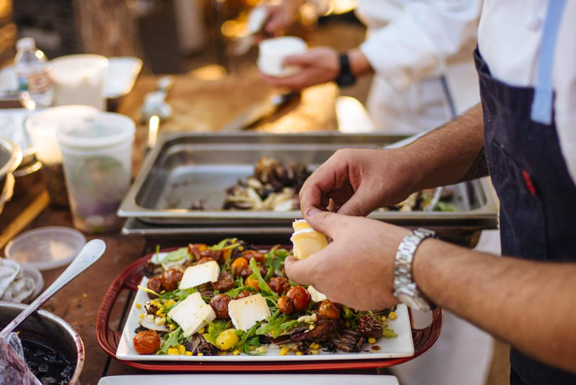 Greg Denton makes the best Grilled Radicchio and corn salad with Mt Tam triple cream and roasted tomato vinaigrette at The Resort at Paws Up Cookbook Live during the chuckwagon, The Taste Edit