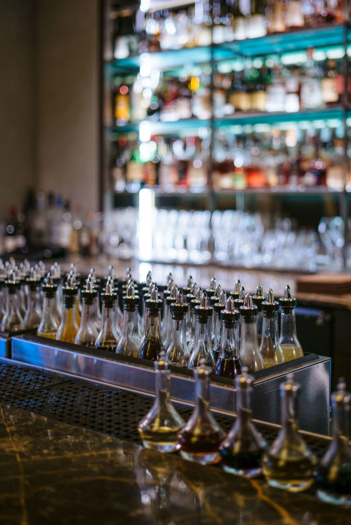The bar at Eleven Madison Park in New York City has a new bar filled with all of the syrups, shrubs, and liquors needed for amazing cocktails, The Taste Edit