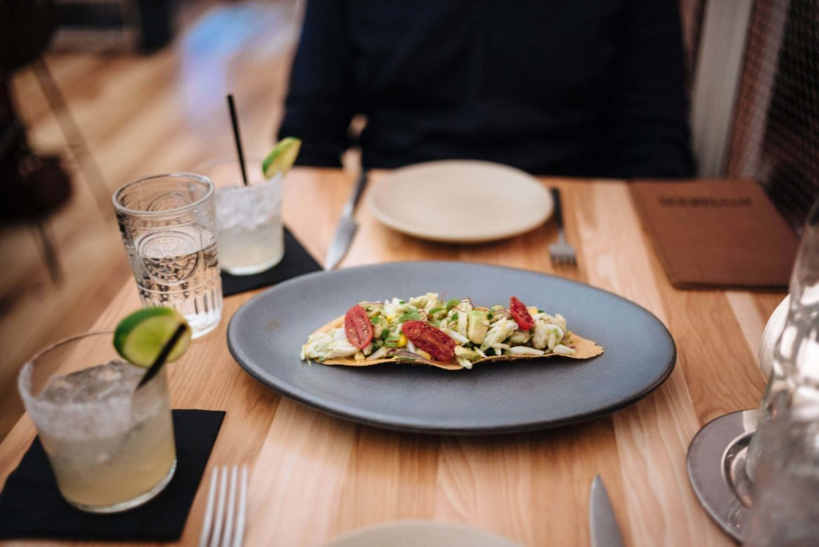 The Taste Edit Culinary and Travel bloggers and photographers visits ATX Cocina the best Modern Mexican Austin restaurant - try the tostadas – jumbo lump crab, corn, avocado, tomato, tomatillo salsa, herbs