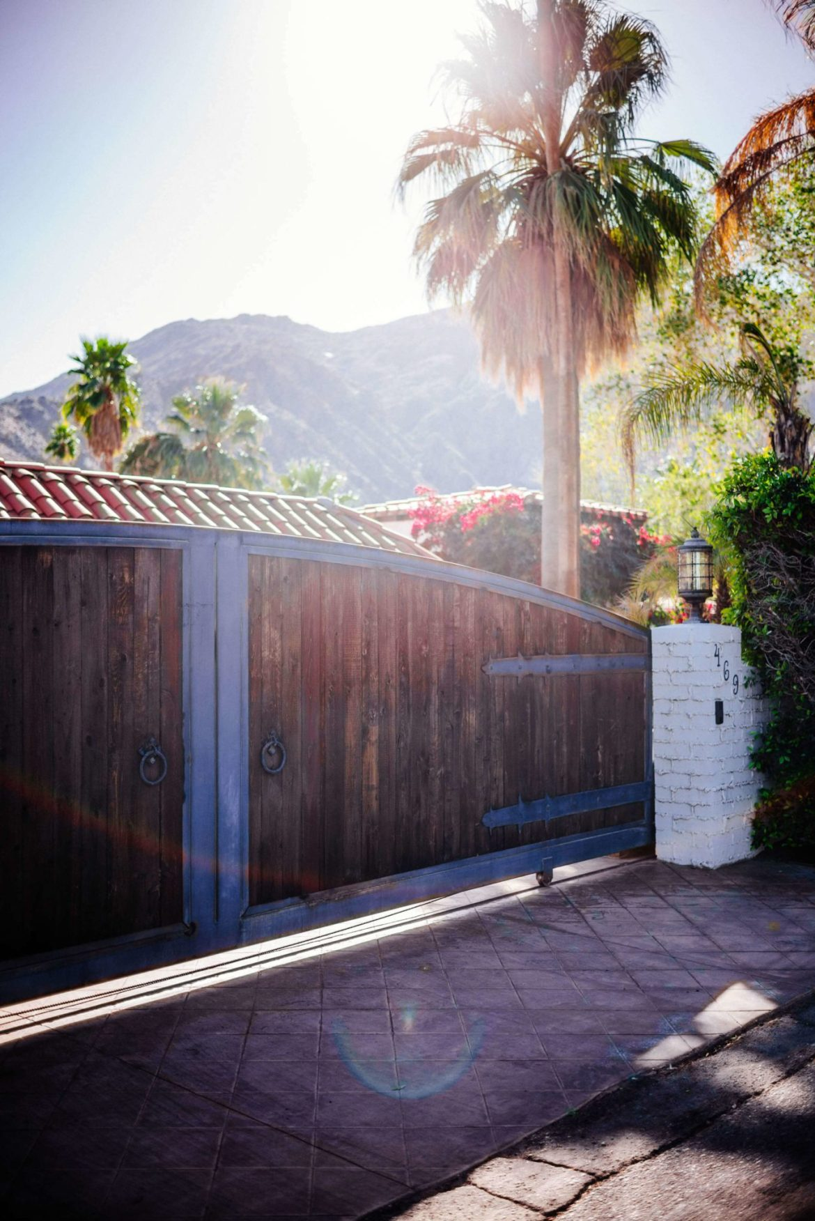 The wooden gate holds back a beautiful home in Palm Springs : Tour the beautiful Mid Century Homes in Palm Springs, The Taste Edit