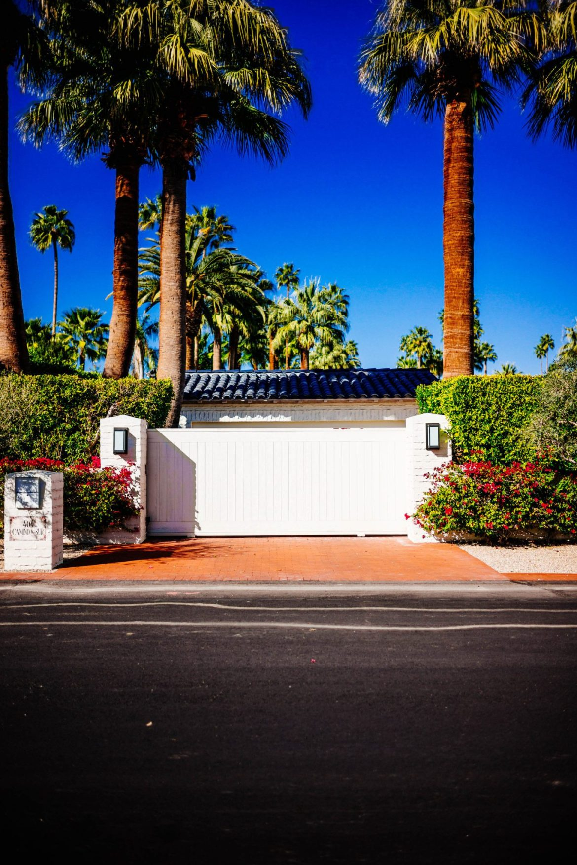 We love the blue tile roof on this home : Tour the beautiful Mid Century Homes in Palm Springs, The Taste Edit