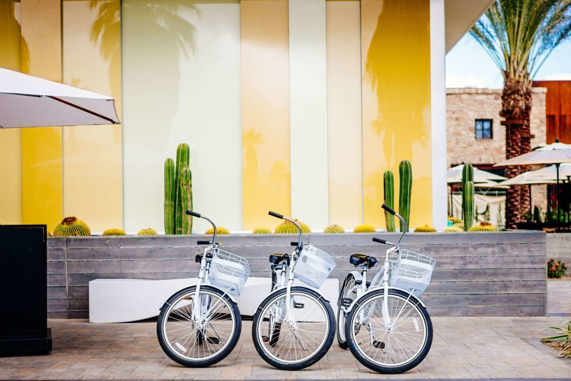 Take a bicycle to tour Palm Springs homes when you stay at the Kimpton Rowan Hotel in Palm Springs is a dessert retreat, The Taste Edit