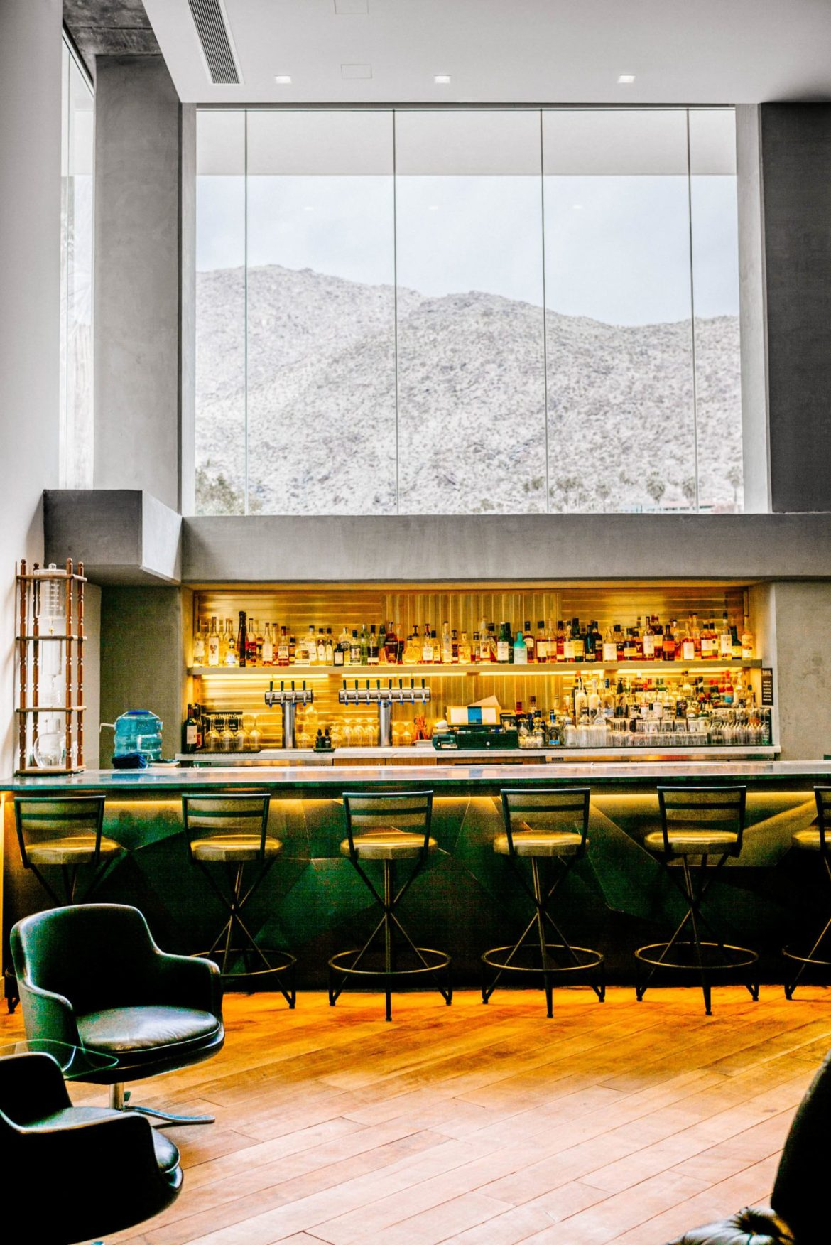 When you stay at the Kimpton Rowan Hotel in Palm Springs there's a fantastic bar with a view and wine happy hour, it's a dessert retreat, is clean, and modern, The Taste Edit