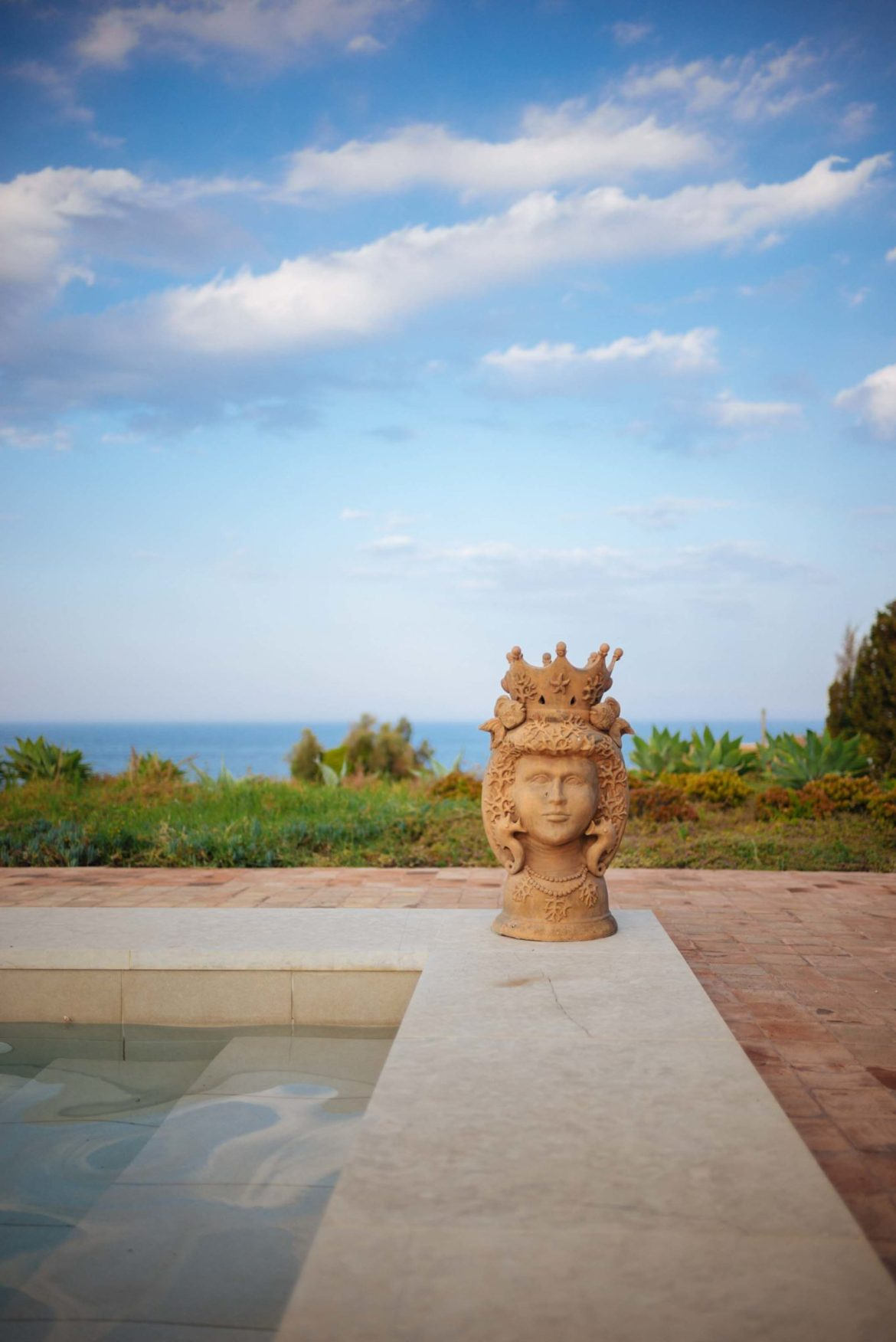 The Taste Edit stays at Villa Don Venerando in Sicily with the Thinking Traveler who's pool looks over the sea in Italy near Catania and Taromina.