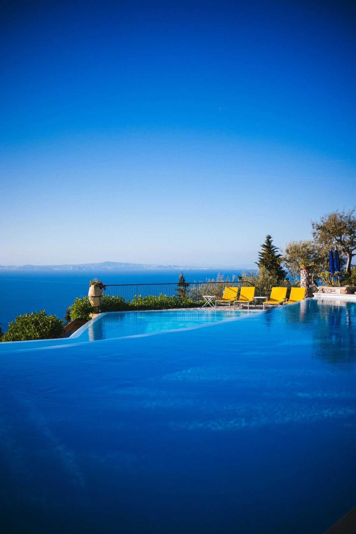 Relax by a double infinity pool at Hotel Caesar Augustus Capri Italy on your Amalfi Coast vacation, The Taste Edit