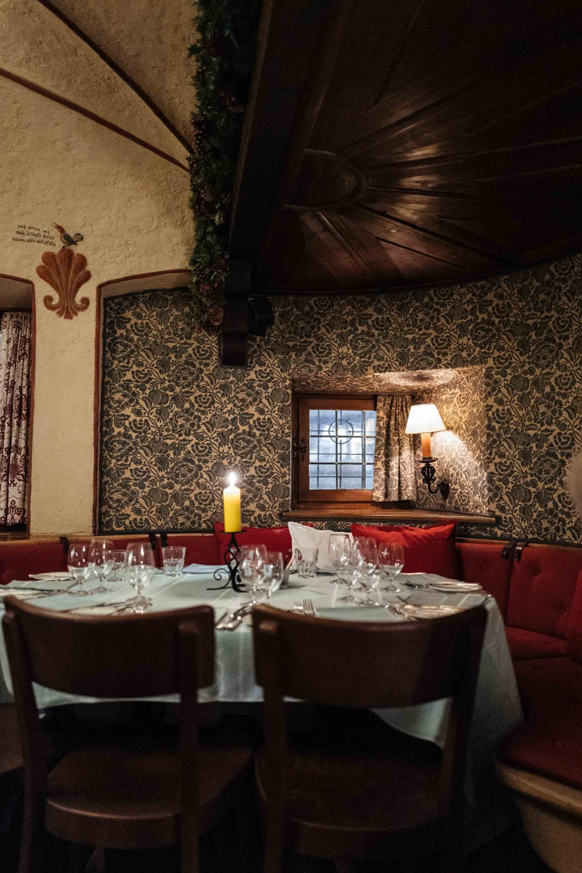 Have dinner in the dining room at this Klosters Hotel or have a set table in the bar downstairs at the historic chesa grischuna of Klosters at night near Davos | The Taste Edit #travel #switzerland #swiss #bar #food #tablesetting