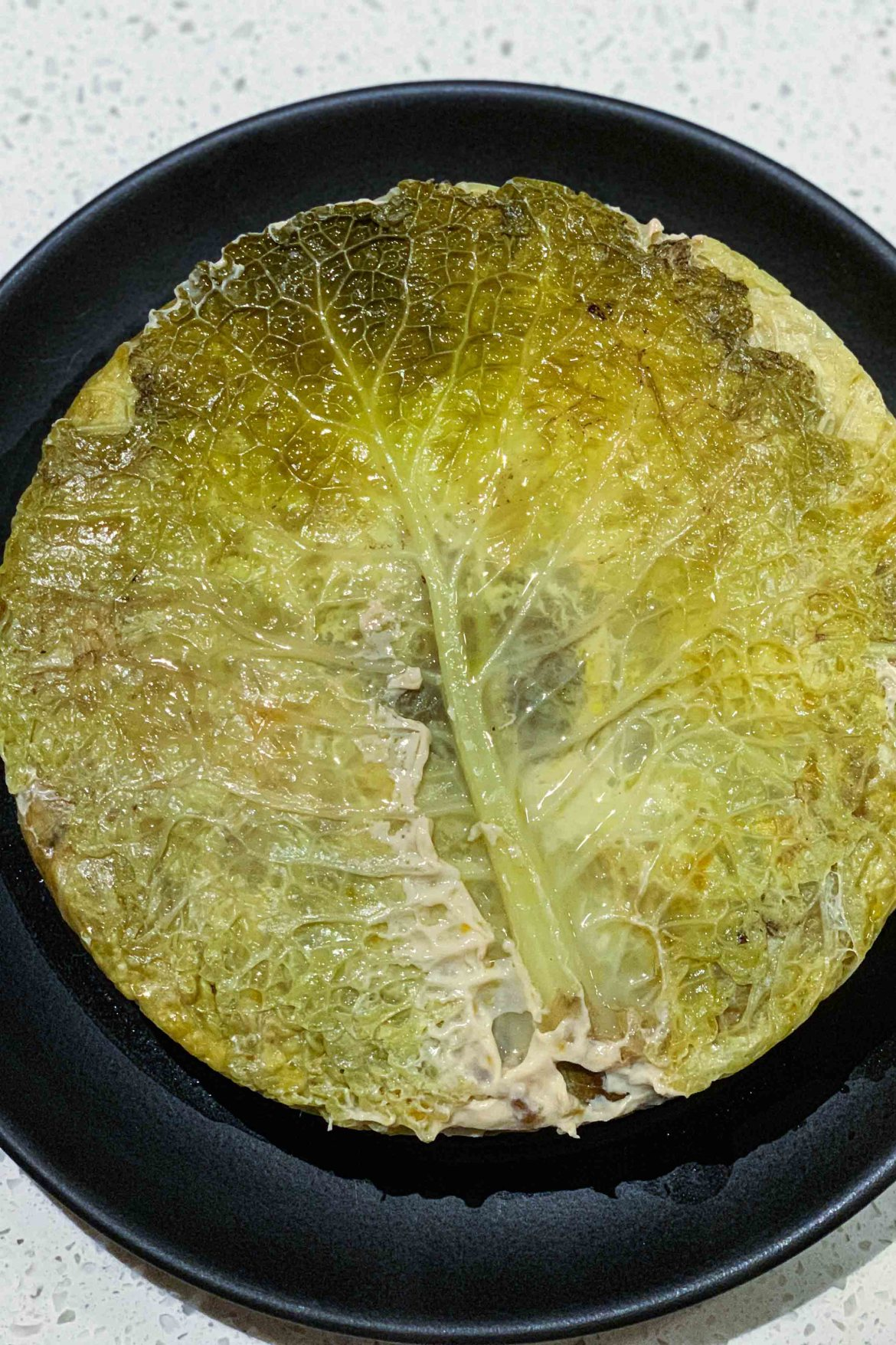 A Chou Farci is a simple French Stuffed Cabbage Recipe filled with layers of beef or pork, carrots, mirepoix, and rice or lentils. You can even make a vegetarian version. | thetasteedit.com #recipe #cabbage #French