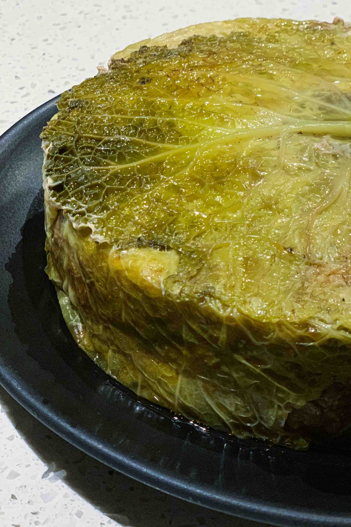Make a French whole Stuffed Cabbage Cake called a Chou Farci. Cut a slice for lunch or dinner. | thetasteedit.com #recipe #cabbage #French