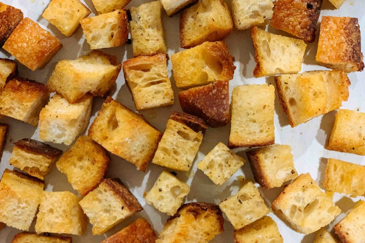 Use your leftover bread to make the best oven-roasted homemade croutons to add to your soup, salad, or even for a snack   thetasteedit.com #recipe #bread #salad