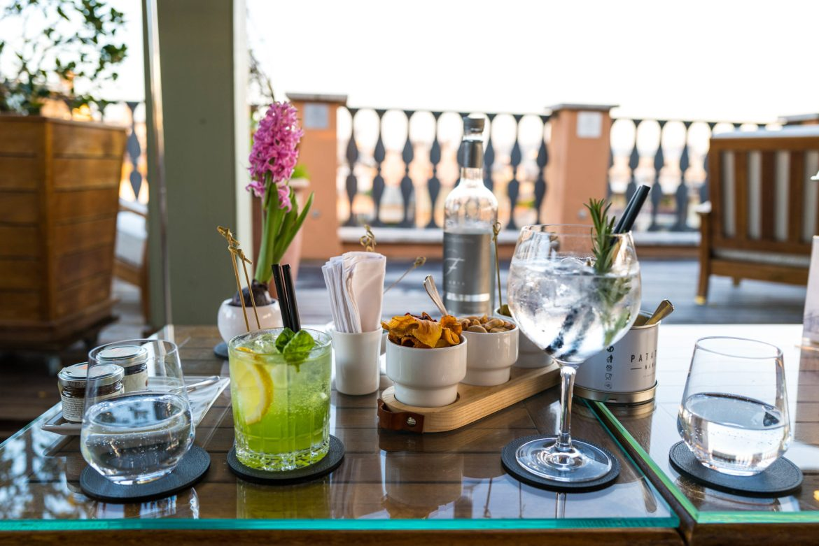 Aperitivo - basil smash and gin and tonic - on the rooftop terrace at the Portrait Roma owned by the Ferragamo Family Rome Hotel, The Taste Edit