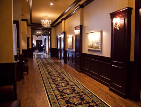 Austin Maggiano's Little Italy Bar Hallway leading to multiple banquet rooms