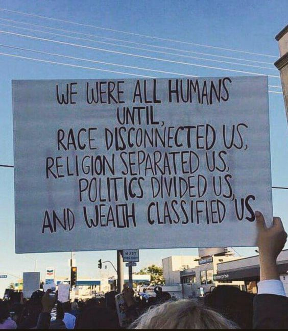 humans protest sign