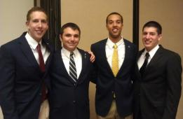 Brothers Richard Snodgrass, Chase Sturdevant, Cedric Pittman, and Justin Aguiliar in formal attire.