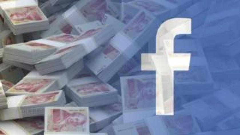 Facebook logo over money