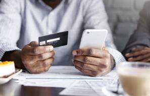 Person-Holding-Credit-Card-and-Mobile