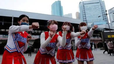 'Let's go fight': Cheerleaders perform outside Tokyo rail station to lift people's spirits – it s viral