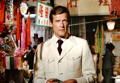 Roger Moore in the iconic Bond safari suit via esquire.com