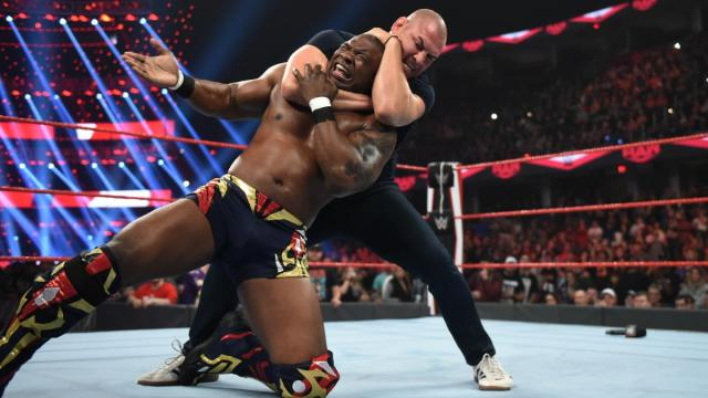 Cain Velasquez putting Shelton Benjamin in a rear naked choke via WWE.com