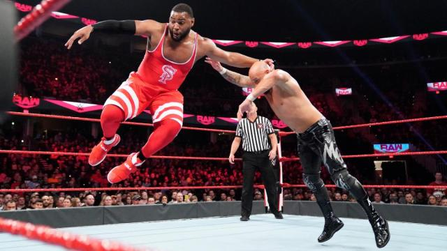 Angelo Dawkins of The Street Profits taking on Karl Anderson of The O.C. via WWE.com