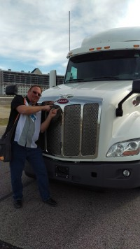 """""""Guru Of Geek"""" Marlo Anderson in front of the Peterbilt Automated Driving Truck"""
