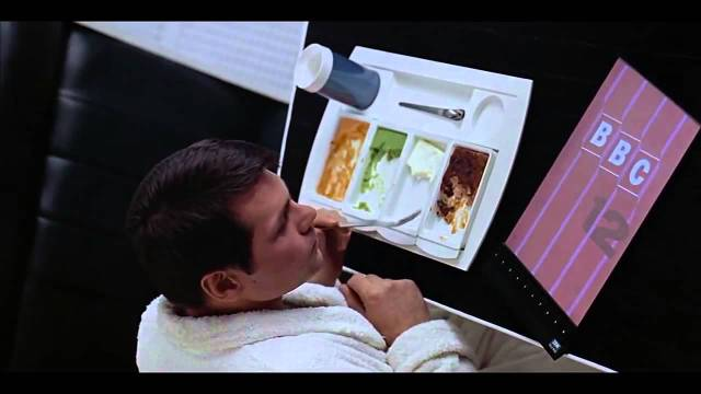 scene from 2001 space odyssey where man watches BBC on a tablet
