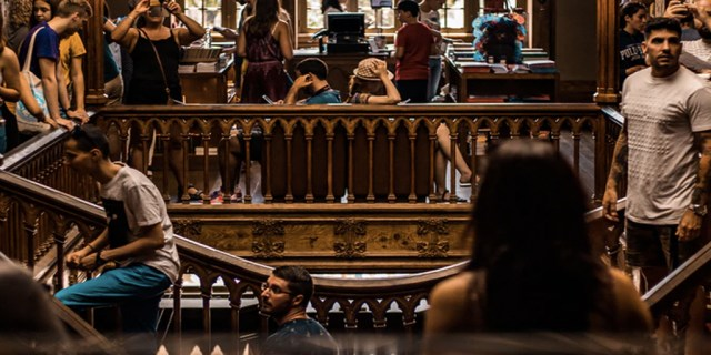 A picture of students in a university library.