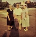 "Rosie S. Morris with Millard Ayers ""Boots"" and Helen Hoagland Mason. Mississippi Gulf Coast Out for supper at the ""White House""  Restaurant. It used to be a favorite place to dine for many Gulf Coast residents. I believe that shadow photographer may be my mother's shadow and I would have been four years old at the time of this photo so was that me beside her?"