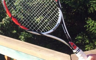 tennis-tourist-racquet-in-garden-teri-church