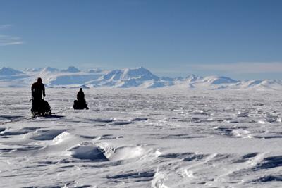 Travelling over sastrugi, with Royal Society Range in background (Nov 2011)