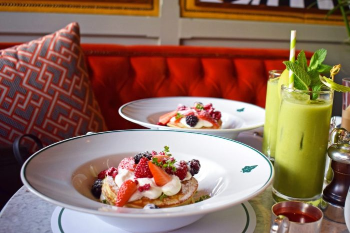 Breakfast at The Ivy: Two plates of pancakes and green juices