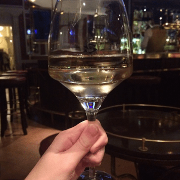 An after-dinner class of wine at The Shelbourne Hotel's classic Horseshoe Bar.