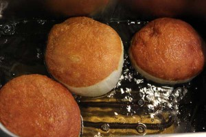 Fry the doughnuts in batches of 3
