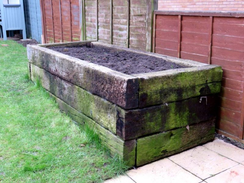 old planter made from railway sleepers